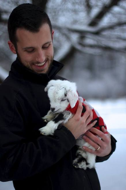 Chris holding Noel. She is wearing an xxs red dog sweater